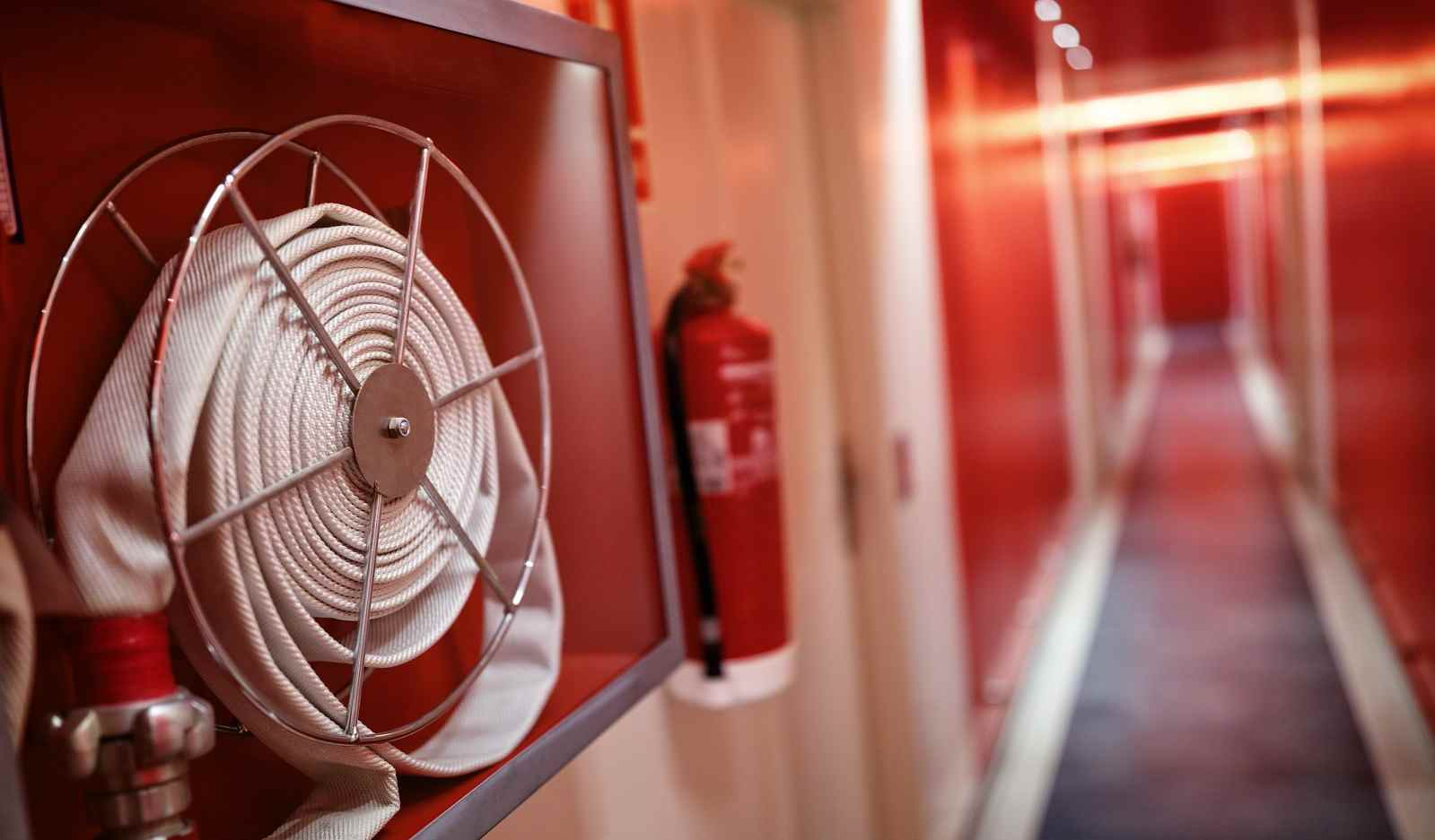 fire extinguisher and hose reel in hotel corridor P7Q39E9 copia compressed